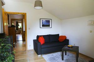 Gemütliche Couch im Wohnraum | Zellerhorn